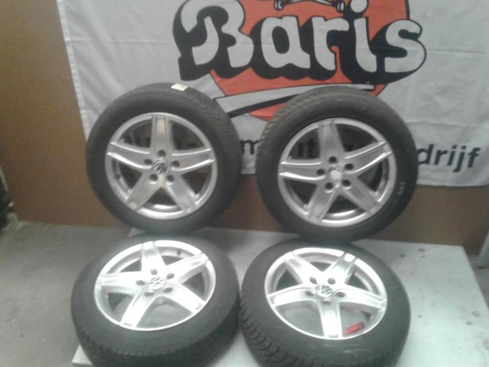 Set of wheels + tyres from a Volkswagen Golf 2009
