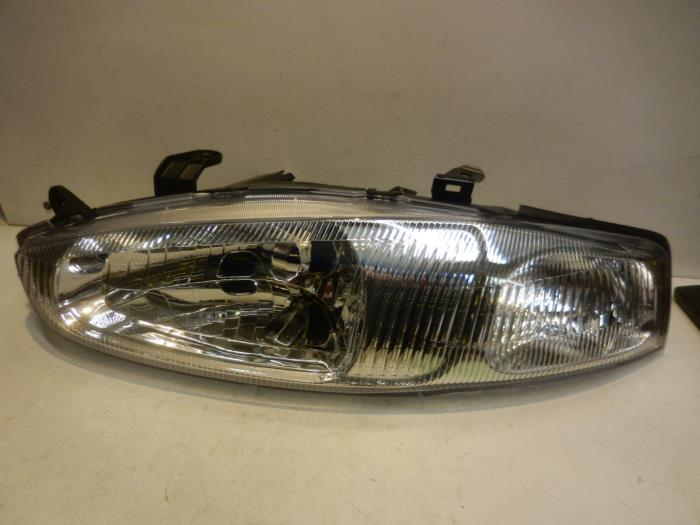 Headlight, left from a Mitsubishi Colt 1999
