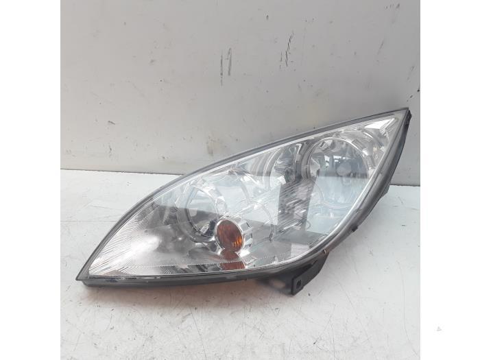 Headlight, left from a Mitsubishi Colt CZC 1.5 16V 2008
