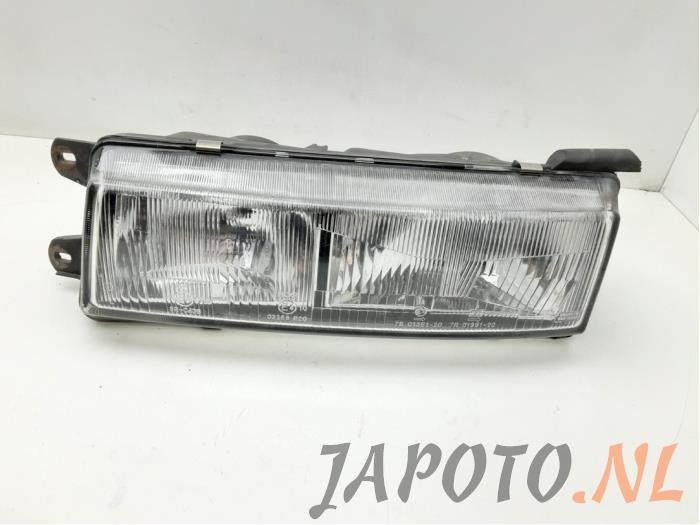 Headlight, left from a Mitsubishi Colt (C5) 1.5 GLi,GLXi 12V Kat. 1991