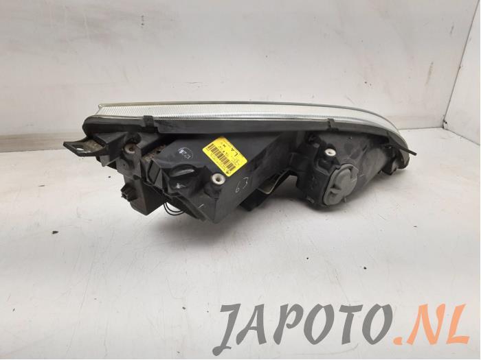 Headlight, left from a Mitsubishi Colt (Z2/Z3) 1.3 16V 2006
