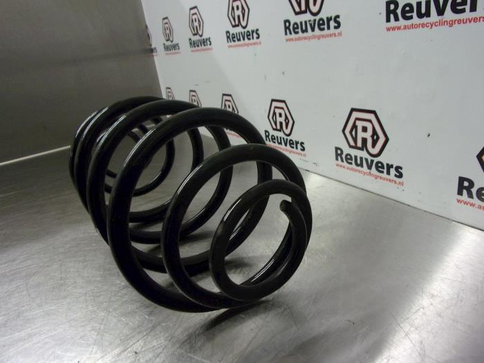 Rear coil spring from a Opel Astra H (L48) 1.6 16V Twinport 2004