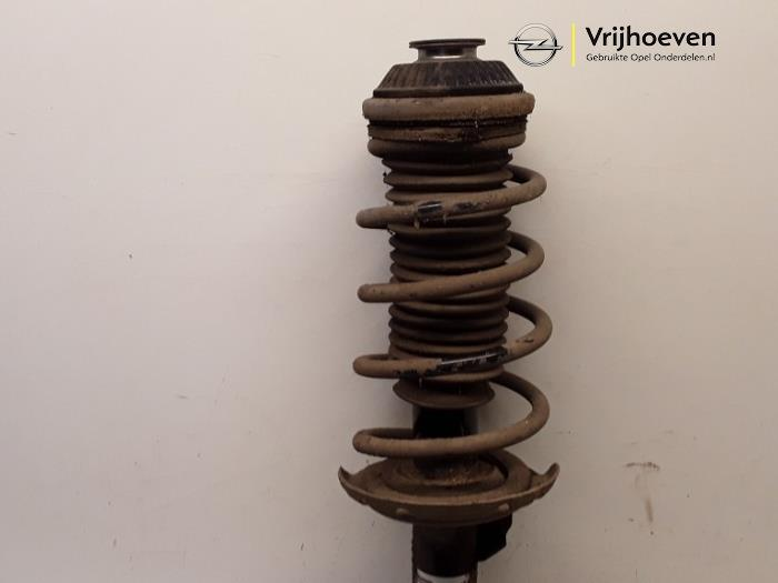 Fronts shock absorber, left from a Opel Astra H (L48) 1.6 16V Twinport 2006