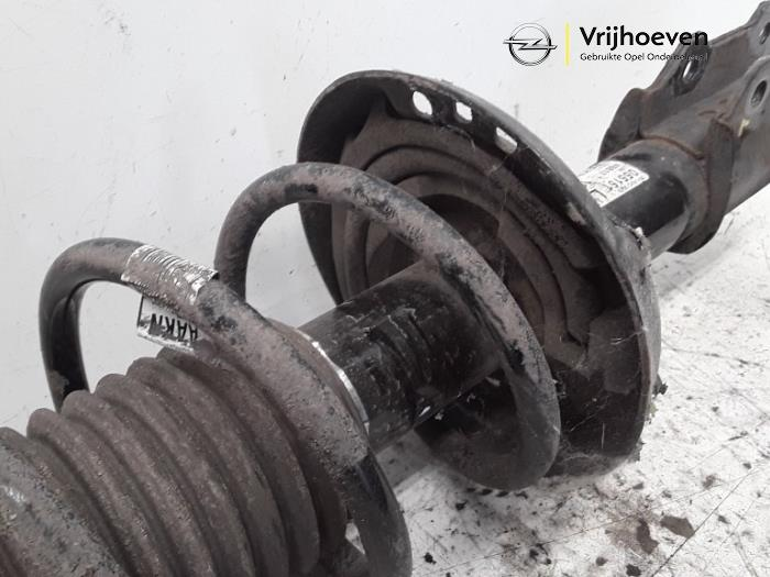 Fronts shock absorber, left from a Opel Astra J Sports Tourer (PD8/PE8/PF8) 1.6 16V 2014