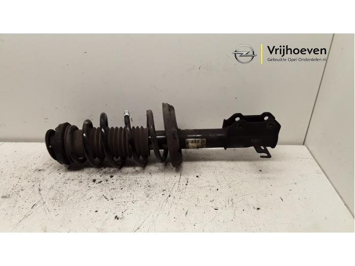 Fronts shock absorber, left from a Opel Astra J Sports Tourer (PD8/PE8/PF8) 1.3 CDTI 16V ecoFlex 2013